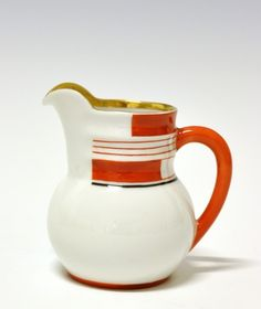Cream jug by Nora Gulbrandsen for Porsgrund Porselen. Production 1931-37. Model 1875 Decor 5328
