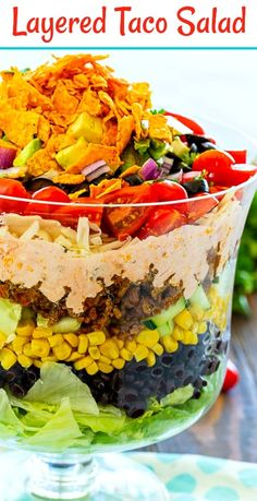 Layered Taco Salad has lots of southwestern flavors. Great for a party or potluck. Layered Taco Salad has all the flavors of tacos piled on top of each other in a trifle dish. It's easy to make ahead for a potluck or party and it will feed a huge crowd. Frito Taco Salad, Taco Salad Recipes, Taco Taco, Nacho Dip, Mexican Dishes, Mexican Food Recipes, Mexican Salads, Layered Taco Salads, Taco Salat