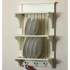 En varios Colores, con tonos pastel, agregarle por delante otras varillas para que no caigan los platos