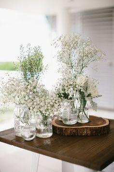 rustic white babys breath wedding centerpiece / http://www.himisspuff.com/simple-elegant-all-white-wedding-color-ideas/8/