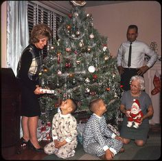 American Family at Christmas — 1964    Slick portrait of an All-American family at Christmas. Looks like the night before – Dad's still wearing his tie.  I totally have that Santa! Mine's just missing the Coke bottle, though.