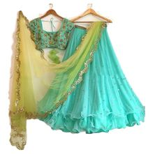 This is an elegant look latest designer lehenga choli and the material is premium quality georgette and it has a very attractive finishing. the lehenga color is sea green and it has a sparkly stone work is designed and the lehenga bottom edge style is very pretty and lehenga has a sea green color shiny inner and this lehenga top side also has a designer lace work. the lehenga has a sea green color blouse and it fully gold color floral zari embroidery work is designed and it looks very pretty…