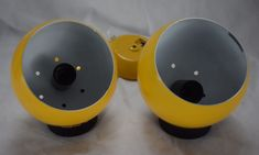 Pair of E.S Horn Aalestrup model 503Designed by Benny Frandsen Yellow metal sphere with wall mount in which there is a  magnet. The sphere is made of enamelled metaland can be positioned inside the magnet to change light dispertion. Can be used as wall mounted lamps or desk lamps. No screws or bulbs included