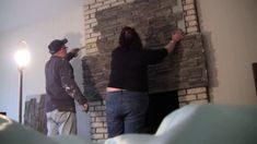 Watch homeowners installing stone veneer over a brick fireplace using Norwich Stacked Stone panels, Misty Morning color. Fireplace Update, Brick Fireplace Makeover, Fireplace Cover, Old Fireplace, Rustic Fireplaces, Stacked Stone Panels, Faux Stone Panels, Faux Panels, Stone Veneer Fireplace
