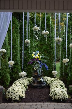 Center arrangement surrounded by hanging crystals and flowers