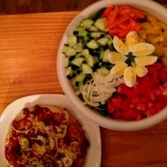 "Garden salad with hard boiled eggs and feta cheese and Deep dish ""favorites"" pizza"