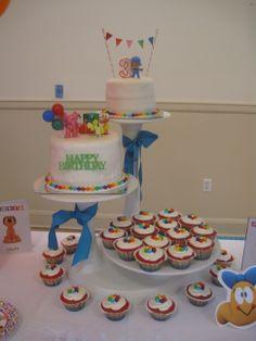 Pocoyo birthday cake; primary color cupcakes with rainbow layers.