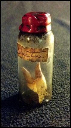 "Cemeteries Ghosts Graveyards Spirits:  ""Vampire Fangs."" A small glass vial containing two forcibly removed vampire fangs. When St. Numerius would shake this vial, the noise would tell nearby vampires that a successful vampire hunter was near, by *JasonMcKittrick."