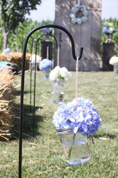 perfect for a country wedding...line the aisle with shepherds hooks of hanging hydrangea.