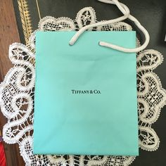 Tiffany & Co. small shopping bag Tiffany & Co. small shopping bag measures 5 by 4 inches. Tiffany & Co. Other