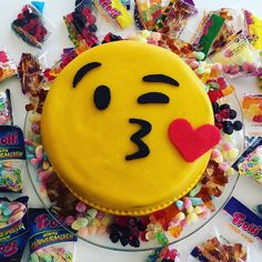 Blow kiss emoji cake filled with candy. Chocolate cake.