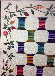 Spool Quilt designed by Edyta Sitar of Laundry Basket Quilts. Pieced by Dianne Civak and custom quilting by Kelly Corfe. Kit available at www.thequiltbee.com