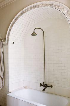 barcelona bathroom with arched shower tub combo. / sfgirlbybay