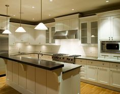 glass pendant kitchen lighting white granite cabinets kitchen lighting handsome white polished wood kitchen island with two tier black granite countertops having single kitchen sink and antique white shaker kitchen cabinet combine frosted glass doors storage 1120x874