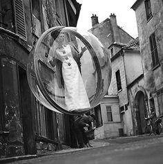 "One of Melvin Sokolsky's famous fashion editorial ""bubble"" photos.  Paris, 1963."