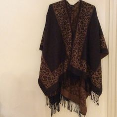 Wrap Never used, 100% acrylic, brown shawl with animal print. Cejon Sweaters Shrugs & Ponchos