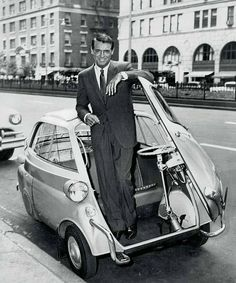 Cary Grant poses in a 1955 BMW Insetta Bmw Isetta, Cary Grant, Microcar, Lamborghini Miura, Miles Davis, Katharine Hepburn, Audi, Pin Up Girls, Vintage Cars
