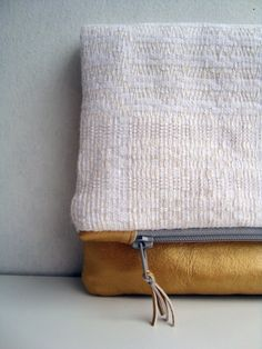 Gold leather and linen clutch by Ingrid