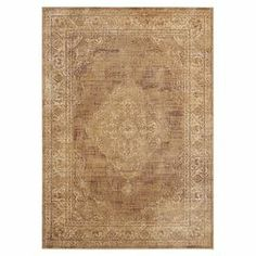 Showcasing a distressed Persian-inspired motif, this loomed art silk rug is equally at home anchoring your breakfast table or placed in the living room.   Product: RugConstruction Material: Art silkColor: TaupeFeatures: Made in IndiaNote: Please be aware that actual colors may vary from those shown on your screen. Accent rugs may also not show the entire pattern that the corresponding area rugs have.Cleaning and Care: Professional cleaning recommended