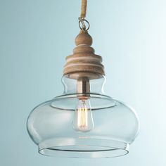 Go light and natural with these pendants of pickled (slight white wash) mango wood, clear glass and raffia-wrapped cords. In two pleasing shapes to use together or individually!