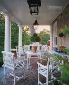 """Perfect porch by Carolyne Roehm at """"Weatherstone"""" her country home in Connecticut."""