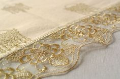 """Table covers beige/gold of Il Gioiello Tablecloth in fabric part of the series """"Ori di Taranto"""" in cotton and lurex. The lace is in tulle with gold embroidery."""