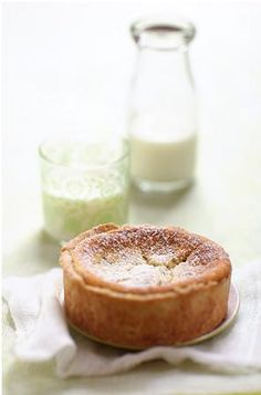 LEMON POPPYSEED YOGURT TART  -   2 eggs...1 c. plain sheep milk yogurt...2/3 c. mascarpone...4 t/ blond cane sugar...2-1/2 T. cornstarch...zest of 1  lemon...1 T. poppy seeds  -  Pastry  -   (use a gluten free one or one that you like)  -  Confectioner's sugar, to dust
