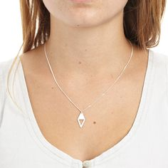 Need!   A diamond shaped sterling silver, with a triangle shape cut out, on a silver chain.