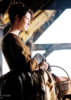 A close-up of Claire at the Castle Leoch stables