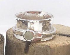 Silver ladies spinner ring, anxiety, meditation jewellery.  Hammered spinning boho festival ring. Jade green gemstone. by LillyAlexandraSilver on Etsy https://www.etsy.com/uk/listing/553633275/silver-ladies-spinner-ring-anxiety