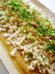 steamed golden needle mushroom in garlic sauce