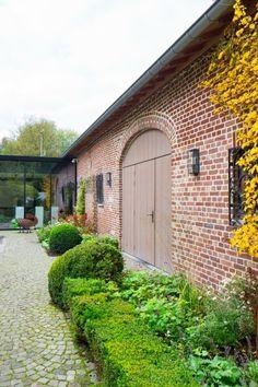 Houten poort in de feestzaal van restaurant Slagmolen. Een geslaagde renovatie!