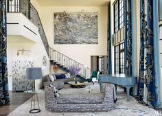 In a New York duplex penthouse outfitted by Jean-Louis Deniot, a monumental Anselm Kiefer painting presides over one end of the living room, where a Vladimir Kagan sofa (clad in an Armani/Casa fabric) from Ralph Pucci International is paired with a cocktail table from Deniot's collection for Jean de Merry.