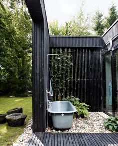 outdoor bath + painted black wood slats : danish summer home
