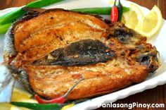 Fried Bangus or Fried milkfish is a simple dish that is packed with flavors. The milkfish alone has its deliciously rich taste (especially the belly) while the marinade gives it a sour spicy flavor. Read Recipe by romathegreat Fish Recipes, Seafood Recipes, Asian Recipes, Dinner Recipes, Cooking Recipes, Pork Recipes, Vegetarian Recipes, Bangus Recipe, Philippines