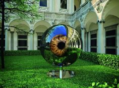 "The Moving Reflective Eyeball Sculpture SPeeCH Tchoban & Kuznetsov is capable of ""looking"" at all of its the visitors in its environment at the Cortile d'Onore of the Ca' Granda's courtyard."
