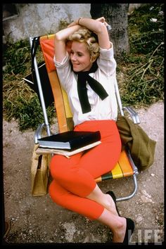 Eva Marie Saint (1960). Reading during break while on location in Israel for the filming of Exodus. LIFE.  The Hitchcock blonde added a pop of color to her prep-meets-mod look with a pair of coral pants and matching lipstick. The Academy Award-winning actress is stylish on set. http://books0977.tumblr.com/