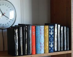 Made of Books  Glue and spray paint real books for these bookends.