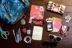 Elsie - Journal by Rifle Paper Co, faux nerd glasses, lock design, Orla Kiely wallet, keys, paint swatches, iPhone, lip glosses, sunglasses, recipe from grandma, American Apparel nail color, headphones, pens, and scissors