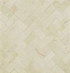 Crema Marfil Herringbone 1920ish look yet still neutral and won't clash with shower floor tile.