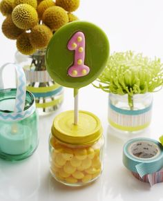 Baby food jar crafts: Upcycle baby food jars into vases, votive holders, and favors for your child's first birthday. From Nafarrete Nafarrete Nery Williams Magazine in the March issue. Baby Food Jar Crafts, Baby Food Jars, Mason Jar Crafts, Food Baby, Baby Crafts, Baby Birthday, First Birthday Parties, Birthday Crafts, Birthday Ideas