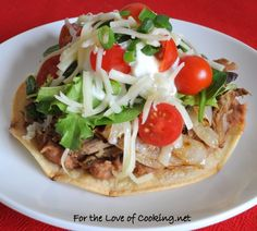 """<p>Tender and juicy pork with sweetened caramelized onions on a crisp corn tortilla.</p> <p><a href=""""http://www.fortheloveofcooking.net/2011/03/shredded-pork-and-caramelized-onion.html"""">RECIPE HERE:<strong>Shredded Pork and Caramelized Onion Tostada</strong></a></p>"""