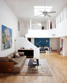 Skylight brings ample natural light into the lower level of the lovely TriBeCa loft
