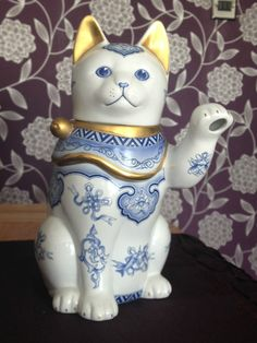 "Franklin Mint Precious Cat of Kiangsi Teapot, in shape of Japanese maneki-neko (literally ""beckoning cat"") lucky cat figure with raised paw as spout, blue and white decoration with gilded ears, collar, ceramic, reproduction"