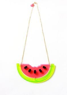 Who took a bite of my melon? Oh wait, it was me! This beautiful watermelon is handmade from transparent green and pink neon acrylic with each black