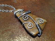 Great way to bind a loose stone! - Wire Wrapped Gemstone.