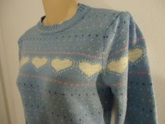 80's sweater... i think i had a few heart sweaters similar to this one.