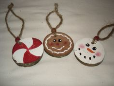 Primitive  Wood Disk Painted Ornaments Snowman Gingerbread Man Peppermint. $9.95, via Etsy.