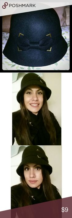 Black Cloche Hat with Bow 100% wool cloche (bell-shaped) hat From Target Excellent condition  One size fits most It seems to catch lint, fur, hair, but lint roller takes care of it  Has a cute bow on side with gold metal accents  All my items come from a smoke free home Target Accessories Hats