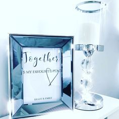 Side table decor | Couple photoframes | Couple bedroom decor | Candlestands | Photo frames | Source: printsbyleahx | #decorideas #newlyweds #homedesign #photoframe #couplequotes #inlove #decoratingideas #sidetable #bedroomfurniture #sidetabledesign #couplebedroom Bedroom Decor For Couples, Couple Bedroom, Side Table Decor, Table Decorations, Newly Married, Newlyweds, Bedroom Furniture, Perfume Bottles, New Homes